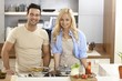 Attractive couple cooking at home