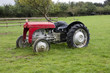 old red tractor in a farm field in uk
