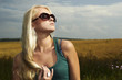 Beautiful blond girl on the field.beauty woman.sunglasses