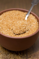 brown sugar in a bowl, selective focus, close-up
