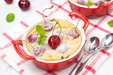 Casserole (clafoutis) with cherry in the ramekin, top view