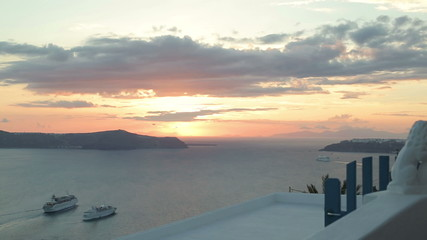 Cruise ships by the Santorini island during sunset