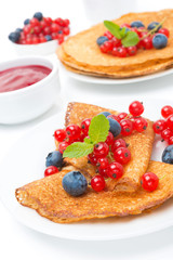 crepes with fresh berries and jam for breakfast