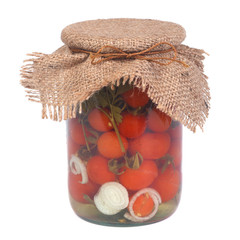 Marinated ripe tomatoes in a glass jar isolated on white