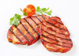 Grilled pork neck steaks
