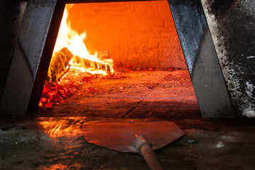 Sicilian wood stove firebox and pizza peel