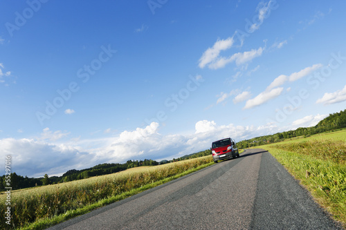 car, suv, driving through fields and meadows