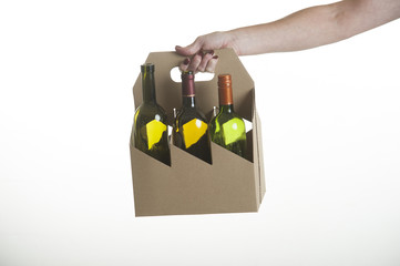 Wine bottle carrier made from recycled cardboard