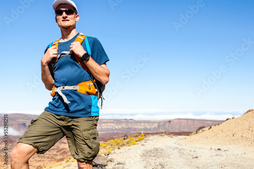 Trail runner or hiker in mountains