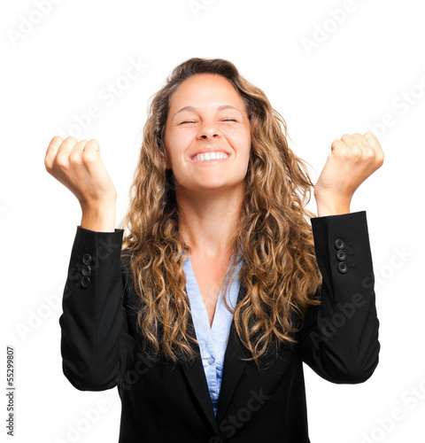 Beautiful happy woman with her arms in the air