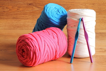 Skeins of zpagetti t-shirt yarn and crochet hooks