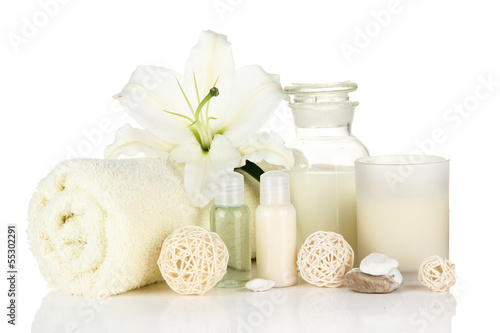 Beautiful spa setting with lily isolated on white