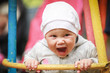 Nice little baby girl laughs on the swing