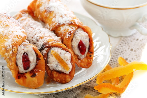 Cannoli with fresh ricotta and candied fruit.