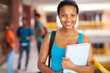 female african college student holding books