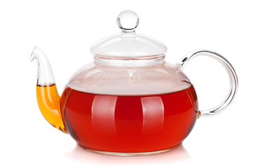 Glass teapot of black tea