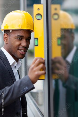 Construction engineer working with level