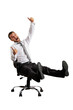 excited businessman sitting on chair