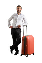 happy man standing with suitcase