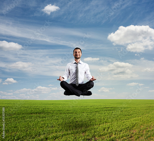 man hover over green field