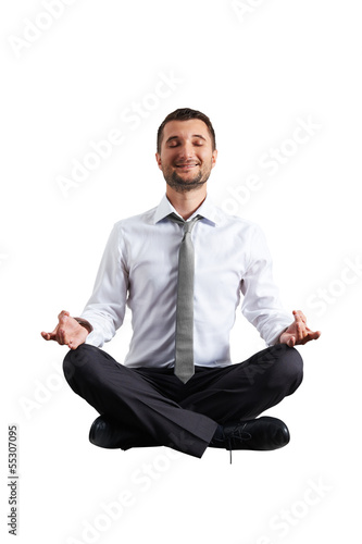 man in formal wear practicing yoga