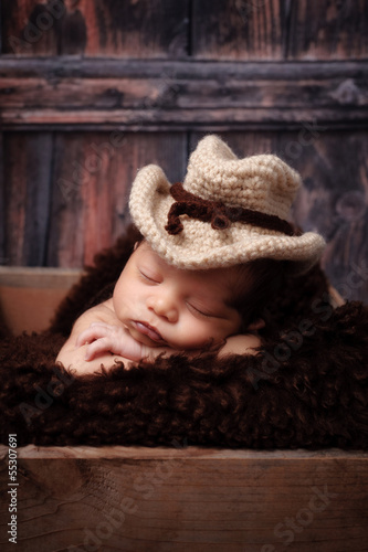 Newborn Baby Boy Wearing a Cowboy Hat