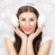 Cute young woman wearing ear muff smiling