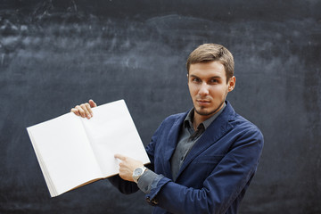 serious teacher showing a notebook