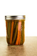 Preserved beans and carrots in a jar