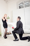 Romantic man proposing to his girlfriend