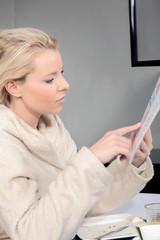 Woman reading a menu at table