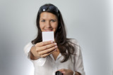 woman holds white plastic card
