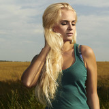 Beautiful blond girl on the field.beauty woman.nature