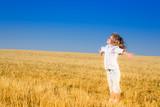 Child in autumn field