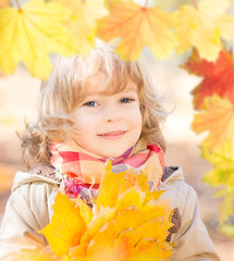 Beautiful child in autumn