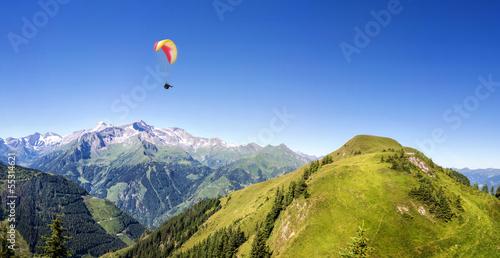 Leinwandbild Motiv Mountain panorama with paraglider