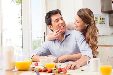Happy Young Couple Enjoying Breakfast