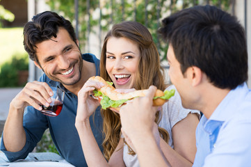 Friends Eating Sandwich