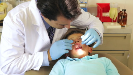 Boy Having Dental Check Up