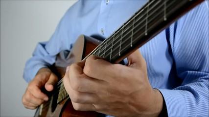 Guitar master playing classical guitar