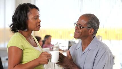 Office Workers Talking During Coffee Break