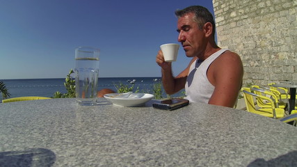 Man Relaxing in Outdoor Restaurant