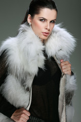 photo beautiful girl is in fashion style is in fur clothes