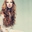 portrait elegant redheaded girl is in lace clothes
