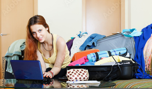 Girl choosing the resort on  internet