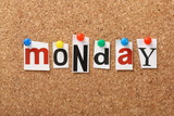 The word Monday on a cork notice board