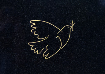An Engraved Gold Dove Of Peace On A Grave In A Cemetery