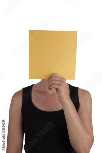 Person Hides Behind a Yellow Square