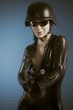 Airsoft, Police woman holding a big gun, latex costume