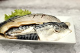 saba fish on a white plate poster